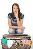 unhappy-frustrated-attractive-young-woman-sitting-overflowing-suitcase-upset-53534651